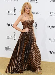 Busy bee: Kylie Minogue proved there is no rest for the wicked as she attended the star-studded Echo Music Awards in Germany's Messe Berlin venue on Thursday evening Hollywood Heroines, Hollywood Actresses, Echo Music, Kylie Minouge, Hollywood Actress Wallpaper, Berlin, Hollywood Pictures, Gold Gown, Famous Girls