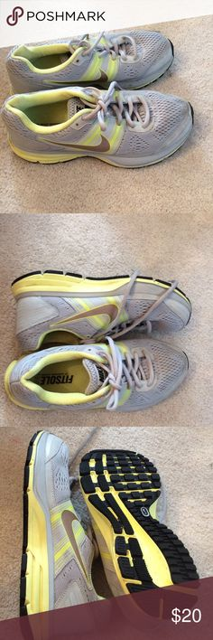 Nike FS running shoe Light gray/yellow running shoe with mesh lining  rubber outsole. Lace up closure. Padded footbed Nike Shoes Athletic Shoes