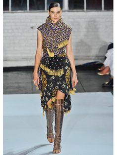 Altuzarra Spring 2013 - I find this reminiscent of the time Scarlett O'Hara made the dress from the curtains in their estate. Whats up with the random tassels??