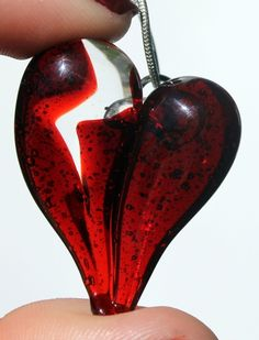Broken Heart  Large Red Lampwork Heart with a jagged crack down the middle. Handblown and then cut to create this look using clear glass in the crack. Wear to show your broken heart or in a Anti valentines protest.