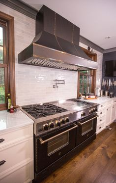 "Iron Chef Micheal Symon's BlueStar kitchen featuring 60"" French Top Range contemporary-kitchen"
