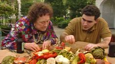 You can spot a young Emeril Lagasse in an episode of Julia Child's show. She appears to be a little smitten with him!