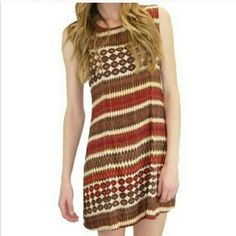 """Relished Sia Dress Perfect for spring and summer! This adorable dress is cool and comfortable, made of 100% Rayon. It looks great with sandals, heels, or boots! It is 33"""" from the shoulder. Machine washable. Relished Dresses"""