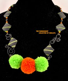 Last Tango in Paris - A fun necklace in shades of lime, orange and black with beads, rubber coated beads  and  handmade pom poms. by ShelleyLChalmers on Etsy