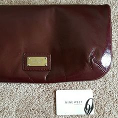 Nine west (Burgandy )(maroon)bifold clutch Pre-owned but never been used.  Nine west clutch so soft and light weigh. Nine West Bags Clutches & Wristlets