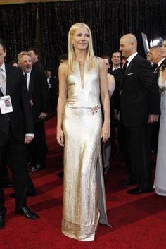 Gwyneth Paltrow in a gold Calvin Klein sheath, 2011
