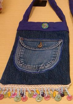Denim Pouch with button fringe quilted lining and by Pinkeeper, $30.00