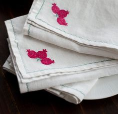 TABLE TEXTILES Crisp white table linen featuring hand embroidered motifs inspired by the blooms & blossoms, crafts & culture along the Silk Route. Shop the Anatolia, Tulip Jaal and Anar Suzani table linen on our #WebBoutique #Suzani #Anar #SilkRoute #GiftIdeas