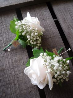 rose and babies breath buttonholes