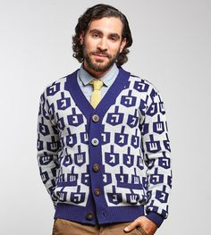 If you don't have callouses on your thumbs and pointer fingers, you are NOT ready to spin against him. Geltfiend's classic Spinmaster Hanukkah sweater features a bold dreidel print in navy and off-white, sustainable wooden buttons and pockets (for. Varsity Sweater, Sweater Cardigan, Men Sweater, Hanukkah Sweater, Army Gifts, Hanukkah Gifts, Sweater Making, Holiday Fashion, Fast Fashion