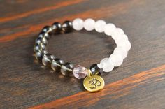 • Opposites Attract! Womens Beaded Yoga Bracelet - OM Charm Bracelet - Smoky Quartz Bracelet - Rose Quartz Bracelet - Lotus and Lava Bracelet •