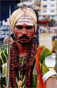 Sadhu with pierced cheeks