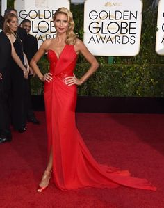 With a little help from her recent Caribbean getaway, Heidi Klum was glowing in a Versace Atelier dress on the Golden Globes red carpet.