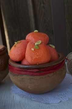 Komola Bhog ( Orange Flavored Cottage Cheese Balls Stewed in Sugar Syrup)