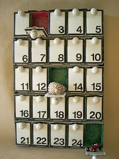 Made from medication boxes you can get at the Dollar Tree or drug stores...genius idea. Christmas Advent calendar???