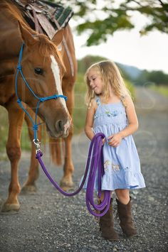 little girl equestrians | Little blonde girl leading her big horse down a country lane ...