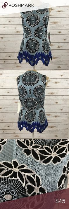 """Top This unique classy top would look amazing paired with black pants.  📐 Measurements & Information 📐  Length Approx 26"""" Chest Approx 36"""" Black lining Sleeveless Zippered back 100% Polyester Thakoon Tops"""