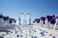 Purple and blue fresh orchid aisle. www.tidetheknotbeachweddings.com