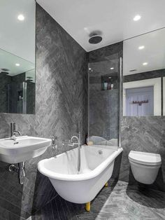 bathroom mirrors create the illusion of space - note large folding door bath screen