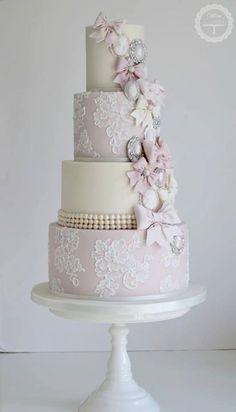 Wedding Cake Inspiration Mauve pink and cream wedding cake with handpainted lace and pearls. Adorned with sugar bows and broaches in silver, pink and white. Cream Wedding Cakes, Wedding Cake Pearls, Floral Wedding Cakes, Elegant Wedding Cakes, Elegant Cakes, Wedding Cake Designs, Lace Wedding, Floral Cake, Purple Wedding