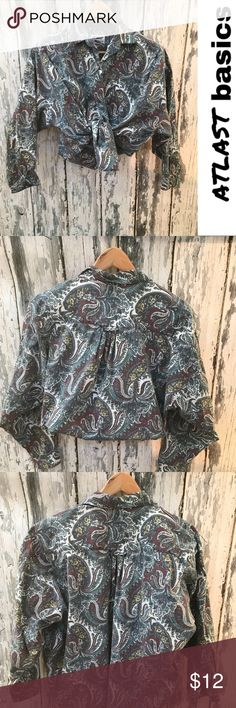 Vintage paisley button down Vintage paisley button down  Perfect to tie up with high waisted pants or put under a sweater (sweater shown is from Anthropologie , also available in my closet)  Perfect condition no  tears or stains Vintage Tops Button Down Shirts