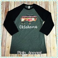 We LOVE our newest design from Plain Apparel. Gray Bella Raglan with Black Sleeves. Buffalo is a hand sewn on applique with the word Oklahoma printed under it.