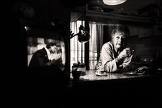 Fausto Podavini - i like the tv being in the shot next to the woman, its like her looking back at her past and her youth