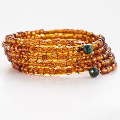 Akola Project Translucent Marigold Coil Bracelet, $10