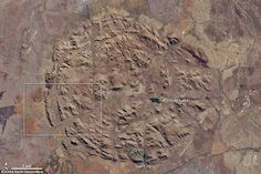 The footprint of a billion-year-old collapsed volcano has been revealed in a stunning Nasa image of South Africa's Pilanesberg National Park. Pilanesberg has the world's largest alkaline ring dike complexes - a rare circular feature that emerged from the subterranean plumbing of an ancient volcano. Seen from space, the concentric rings of hills and valleys make a near perfect circle