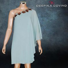 Here comes flirty fly away cocktail dresses in pale mint, aqua blue from the collection TINKER BELL & PIXIE DUST. This gives you a feeling of being in the land of modern fairies & Magic. Silk Georgette & Shimmery silk tissue.  Available at Deepika Govind Bangalore.  #Designerwear #PartyWear #WomensWear #Dresses #Fashion #Fashionista #Women #Luxury #CocktailWear #EveningWear #DeepikaGovind