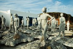 """Sculptures from """"Rubicon,"""" part of Taylor's underwater sculpture exhibit, before being lowered underground off the coast of Lanzarote, Spain. This creation consist of 35 people walking ahead, eyes closed, unaware of the changes ahead."""
