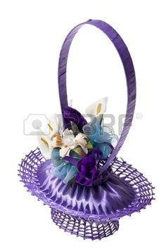 Decorative basket made from a soap, pins and violet ribbon with..