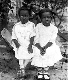 c 1910. Why did they ever think those giant bows made us look...better? I was still cursed with them with them in the early 50s.