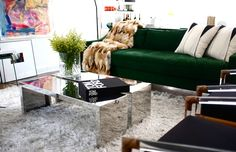 Nicole Cohen perfection- green velvet, fur throw, lucite chairs, chrome coffee table, artwork