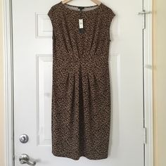"NWT Talbots Sheath Animal Print Dress Size M GORGEOUS  NWT Talbots Sheath Animal Print Dress Size M Definitely one that doesn't sell I'm keeping! Material is extremely forgiving (stretchy) but doesn't feel cheap- the polar opposite! Slight gathering accent at the waist for a slimming effect! BEAUTIFUL! 42.5""L 40"" BUST. A very classic timeless piece! CANT MODEL. FRESHLY CLEANED! OFFERS WELCOME Talbots Dresses"