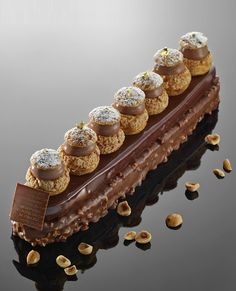 "Eclair - Lilian Bonnefoi - Hotêl du Cap Eden Roc Morpheus: ""If real is what you can feel, smell, taste and see, then 'real' is simply electrical signals interpreted by your brain. Eclairs, Profiteroles, Patisserie Fine, French Patisserie, Patisserie Design, Fancy Desserts, Just Desserts, Dessert Recipes, Healthy Desserts"