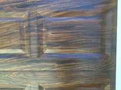 Close up of painted aluminum garage door made to look like stained wood by Holly Blanton Art 904.294.5511