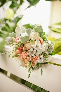 DESCRIPTION: Carry this bouquet to your secret garden.  Use mini roses in soft shades, lamb's ear, and other delicate wildflowers