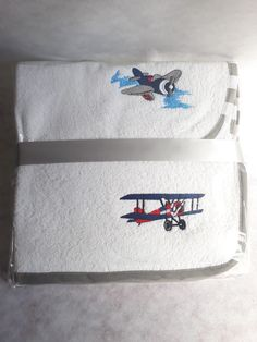 2 x grey burp cloths Embroidered with elegant planes. For sale on our online store www.amjembrpidery.co.za