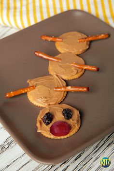 Make a caterpillar out of peanut butter, RITZ crackers, raisins and pretzels. Cute, easy and a delicious snack for kids and adults.