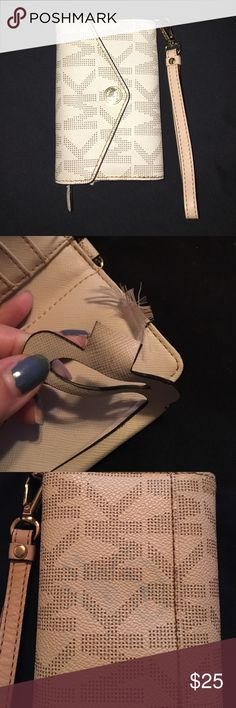 Michael kors iPhone 5 wristlet It's authentic! It has flaws. All last three pictures. There's a small rip and another by the phone section. On the back there is a light blue stain. Michael Kors Bags Clutches & Wristlets