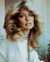 Everybody wanted Farrah Fawcett hair. For people like me with totally straight hair that won't even hold with a perm, impossible! <3 nana gloria