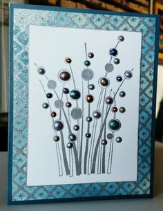 Spring Gems by Hero Arts with Nuvo Crystal accents. Silver embossing powder and washi paper.