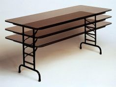 Standard Adjustable Height Folding Table in Walnut (30 in. x 72 in./Black Granite) by Correll. $311.00. 1.125 in. 14 gauge steel wishbone legs. 0.75 in. high density particle board core with backer sheet. Finish: 30 in. x 72 in./Black Granite. For heavy duty home, office, school, church, food service and commercial use. 1 in. 18 gauge steel pedestal legs. For heavy duty home, office, school, church, food service and commercial use . 0.75 in. high density particle board core wi...