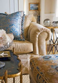 from Traditional Homes -Fortuny fabrics on sofa pillow. The pattern is Campanelle a Morning Glory motif.
