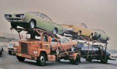 Early 60s Dodge truck hauling new cars