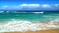 waves crashing on tropical shore with rocks - Google Search