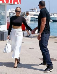 Daytime chic: Jennifer paired the NW top by Naked Wardrobe ($24) with Hermes Pants and Giuseppe Zanotti shoes while out with new boo Alex Rodriguez