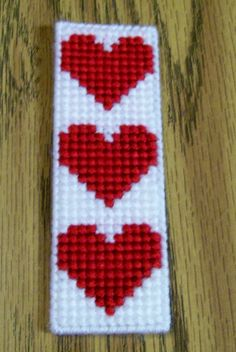 Valentine Bookmark, Plastic Canvas Bookmark, Handmade, Plastic Canvas A great way to mark where you left off reading your book. This bookmark is made with plastic canvas, acrylic yarn using a simple stitch. It measures approximately 5 x Plastic Canvas Books, Plastic Canvas Stitches, Plastic Canvas Coasters, Plastic Canvas Ornaments, Plastic Canvas Tissue Boxes, Plastic Canvas Crafts, Plastic Canvas Patterns, Cross Stitch Stocking, Cross Stitch Bookmarks