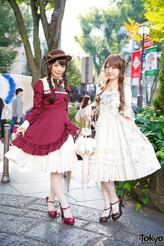 Koharu and Miya on the street in Harajuku wearing lolita fashion from the Japanese brands Mary Magdalene, Innocent World, Alice and the Pirates, and Baby, The Stars Shine Bright.